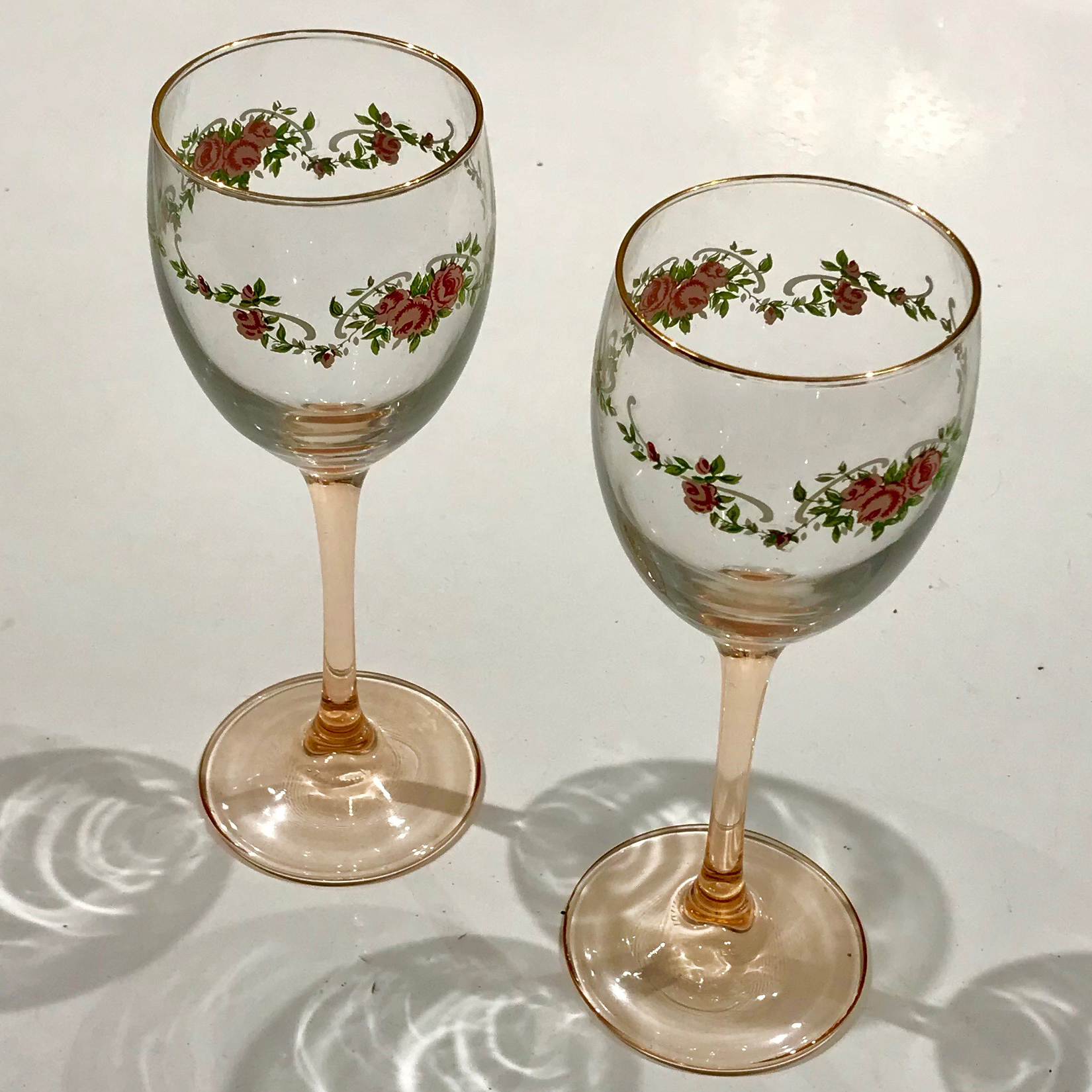 Pair of Vintage English pink stem rose and gilt wine glasses